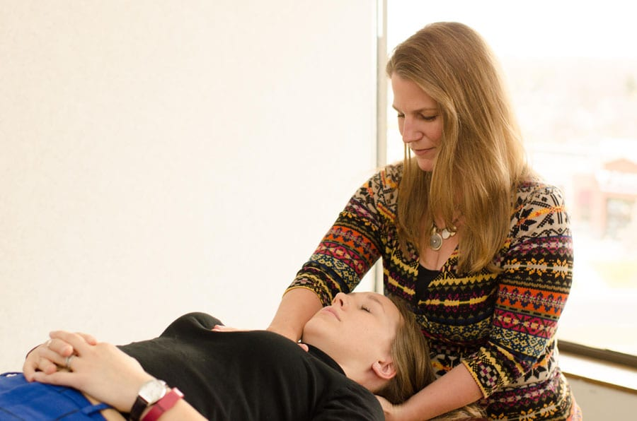 Amy Molzen-Stuke working with a patient